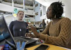 FILE - In this Tuesday, Jan. 24, 2017, file photo, Xonjenese Jacobs, right, helps Kristen Niemi sign up for the Affordable Care Act during a healthcare expo at the University of South Florida, in Tampa, Fla. The Affordable Care Act's fate is unclear. President Donald Trump has vowed to repeal it, but lawmakers have yet to reach an agreement on a replacement, leaving millions of people wondering how to deal with the ACA's uncertain future. (AP Photo/Chris O'Meara, File)