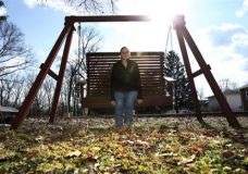 """In this Monday, Jan. 30, 2017, photo, Ashley Grant sits on a swing near her home in Bridgeton, N.J. Drug addicts caught up in the nation's opioid-abuse crisis are worried about what will happen if the Trump administration makes good on its vow to repeal the Affordable Care Act. Grant, a recovering heroin addict is hoping to regain custody of her three children. """"They should make it easier for people with addiction to get insurance,"""" she said. (AP Photo/Mel Evans)"""