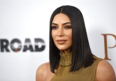 "FILE - In this April 12, 2017, file photo, Kim Kardashian West arrives at the U.S. premiere of ""The Promise"" at the TCL Chinese Theatre in Los Angeles. Kardashian West tells Ellen DeGeneres on the April 27, 2017, episode of the comedian's chat show that she's ""such a different person"" after being held at gunpoint during a Paris jewelry heist last year. (Photo by Chris Pizzello/Invision/AP, File)"