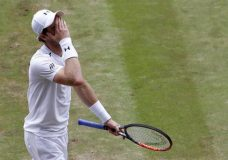 Britain's Andy Murray reacts after losing a point to Sam Querrey of the United States during their Men's Singles Quarterfinal Match on day nine at the Wimbledon Tennis Championships in London Wednesday, July 12, 2017. (AP Photo/Kirsty Wigglesworth)