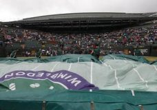 Court number one is covered as it rains on day eight at the Wimbledon Tennis Championships in London Tuesday, July 11, 2017. (AP Photo/Kirsty Wigglesworth)
