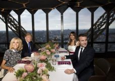 President Donald Trump, first lady Melania Trump, French President Emmanuel Macron his wife Brigitte Macron, are photographed as they sit for dinner at the Jules Verne Restaurant on the Eiffel Tower in Paris, Thursday, July 13, 2017. (AP Photo/Carolyn Kaster)