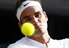 Switzerland's Roger Federer eyes the ball before returning to Bulgaria's Grigor Dimitrov during their Men's Singles Match on day seven at the Wimbledon Tennis Championships in London Monday, July 10, 2017. (AP Photo/Kirsty Wigglesworth)
