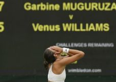 Spain's Garbine Muguruza celebrates after beating Venus Williams of the United States to win the Women's Singles final match on day twelve at the Wimbledon Tennis Championships in London Saturday, July 15, 2017. (AP Photo/Tim Ireland)