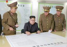 "This image made from video of an Aug. 14, 2017, still image broadcast in a news bulletin on Tuesday, Aug. 15, 2017, by North Korea's KRT shows North Korean leader Kim Jong Un receiving a briefing in Pyongyang. North Korea said leader Kim Jong Un was briefed on his military's plans to launch missiles in waters near Guam days after the Korean People's Army announced its preparing to create ""enveloping fire"" near the U.S. military hub in the Pacific. Independent journalists were not given access to cover the event depicted in this photo. (KRT via AP Video)"