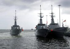 Republic of Singapore Navy's RSS Brave, left, sails off from Tuas naval base on a search and rescue mission for USS John S. McCain's missing sailors on Thursday, Aug. 24, 2017, in Singapore. Aircraft and ships from the navies of Singapore, Malaysia, Indonesia and Australia are searching seas east of Singapore where the collision between the USS John S. McCain and an oil tanker happened early Monday. (AP Photo/Wong Maye-E)