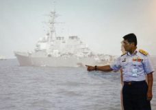 """Malaysian Maritime Director Indera Abu Bakar points the damage of USS John S. McCain shown on a screen during a press conference in Putrajaya, Malaysia, Monday, Aug. 21, 2017. The U.S. Navy said the USS John S. McCain arrived at Singapore's naval base with """"significant damage"""" to its hull after a collision early Monday between it and an oil tanker east of Singapore. A number of U.S. sailors are missing after the collision, the second accident involving a ship from the Navy's 7th Fleet in the Pacific in two months. (AP Photo/Daniel Chan)"""