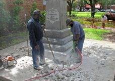 Workers begin removing a Confederate statue in Gainesivlle, Fla., Monday, Aug. 14, 2017. The statue is being returned to the local chapter of the United Daughters of the Confederacy, which erected the bronze statue in 1904. County officials said they did not know where the statue would be going. (AP Photo/Jason Dearen)