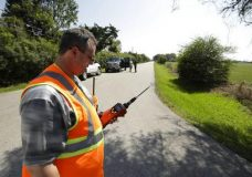 Mike Cossey, of Bureau Veritas, uses an air monitor to check the quality of air at a police roadblock marking the 1.5-mile perimeter of the evacuation area around the Arkema Inc. chemical plant Thursday, Aug. 31, 2017, in Crosby, Texas. The Houston-area chemical plant that lost power after Harvey engulfed the area in extensive floods was rocked by multiple explosions early Thursday, the plant's operator said. The Arkema Inc. plant had been left without refrigeration for chemicals that become volatile as the temperature rises. (AP Photo/Gregory Bull)
