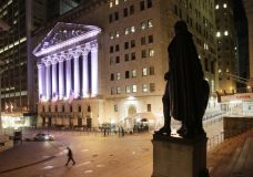 FILE - In this Wednesday, Oct. 8, 2014, file photo, a statue of George Washington stands near the New York Stock Exchange, in background. U.S. stocks are lower early Thursday, Sept. 28, 2017, as technology companies decline and smaller companies slip after a rally brought them to record highs. Drug and medical device maker Abbott Laboratories is climbing after regulators approved its new blood glucose monitoring system for diabetes patients. Energy companies are higher as the price of oil rises. (AP Photo/Mark Lennihan, File)