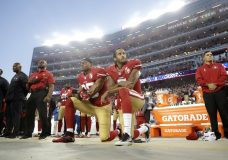 FILE - In this Sept. 12, 2016, file photo, San Francisco 49ers safety Eric Reid (35) and quarterback Colin Kaepernick (7) kneel during the national anthem before an NFL football game against the Los Angeles Rams in Santa Clara, Calif. What began more than a year ago with a lone NFL quarterback protesting police brutality against minorities by kneeling silently during the national anthem before games has grown into a roar with hundreds of players sitting, kneeling, locking arms or remaining in locker rooms, their reasons for demonstrating as varied as their methods. (AP Photo/Marcio Jose Sanchez, File)