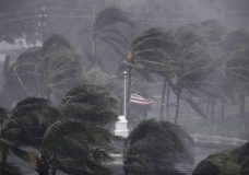 An American flag is torn as Hurricane Irma passes through Naples, Fla., Sunday, Sept. 10, 2017. (AP Photo/David Goldman)