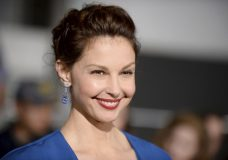 """FILE - In this March 18, 2014, file photo, Ashley Judd arrives at the world premiere of """"Divergent"""" at the Westwood Regency Village Theater in Los Angeles. Judd on """"Good Morning America,"""" Thursday, Oct. 26, 2017, said Harvey Weinstein made sexual advances toward her two decades ago. Judd was among the first of what has become dozens of women alleging sexual harassment or assault by Weinstein, who is now under criminal investigation for rape in several cities. (Photo by Jordan Strauss/Invision/AP, File)"""
