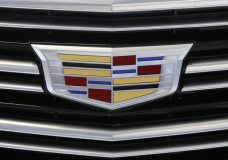 FILE - This Thursday, Feb. 11, 2016, file photo shows the Cadillac logo, a General Motors Co. brand, on display on a vehicle at the Pittsburgh International Auto Show in Pittsburgh. General Motors Co. reports earnings Tuesday, Oct. 24, 2017. (AP Photo/Gene J. Puskar, File)