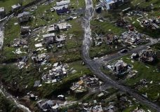 FILE - In this Sept. 28, 2017, file photo, debris scatters a destroyed community in the aftermath of Hurricane Maria in Toa Alta, Puerto Rico. The Senate is pushing ahead on a $36.5 billion hurricane relief package that would give Puerto Rico a much-needed infusion of cash but rejects requests from the powerful Texas and Florida congressional delegations for additional money to rebuild after hurricanes Harvey and Irma. The measure is sure to sail through a Monday, Oct. 23, procedural vote and a final vote is expected no later than Tuesday. (AP Photo/Gerald Herbert, File)