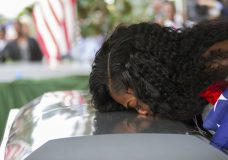 """FILE - In this Saturday, Oct. 21, 2017, file photo, Myeshia Johnson kisses the casket of her husband, Sgt. La David Johnson during his burial service at Fred Hunter's Hollywood Memorial Gardens in Hollywood, Fla. Myeshia Johnson told ABC's """"Good Morning America"""" on Monday, Oct. 23, 2017, that she has nothing to say to the president, adding that his phone call to her made """"me cry even worse."""" (Matias J. Ocner/Miami Herald via AP, File)"""