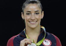"""FILE - In this Aug. 16, 2016, file photo, United States' Aly Raisman shows off her silver medal after the artistic gymnastics women's apparatus final at the 2016 Summer Olympics in Rio de Janeiro, Brazil. Six-time Olympic medal winning gymnast Aly Raisman says she is among the young women abused by a former USA Gymnastics team doctor. Raisman tells """"60 Minutes"""" she was 15 when she was first treated by Dr. Larry Nassar, who spent more than two decades working with athletes at USA Gymnastics but now is in jail in Michigan awaiting sentencing after pleading guilty to possession of child pornography. (AP Photo/Dmitri Lovetsky, FIle)"""