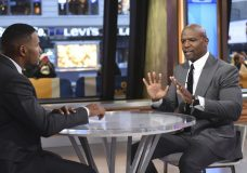 "This image released by ABC shows actor Terry Crews, right with co-host Michael Strahan during a segment on ""Good Morning America,"" Wednesday, Nov. 15, 2017, in New York. Crews told Strahan that he ""never felt more emasculated"" than when a powerful Hollywood agent groped him at a party last year. Crews confirmed that he recently filed a police report against a top agent at William Morris Endeavor. The star of TV's ""Brooklyn Nine-Nine"" says he felt empowered to share his experience after so many women came forward with allegations against Weinstein. (Paula Lobo/ABC via AP)"