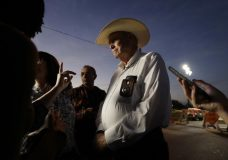 Wilson County Sheriff Joe Tackitt Jr. provides an update to the media at the scene of a shooting at the First Baptist Church of Sutherland Springs, Monday, Nov. 6, 2017, in Sutherland Springs, Texas. A man opened fire inside the church in the small South Texas community on Sunday, killing and wounding many. (AP Photo/Eric Gay)