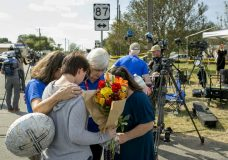 Chaplains Sharon Folsom, left, and Jeanie Tidwell, second from right, of Billy Graham Rapid Response Team, pray with Belinda McLaurin, right, and her 14-year-old granddaughter, Randi Ray Rivera, near the scene of the mass shooting at First Baptist Church in Sutherland Springs, Texas, on Tuesday, Nov. 7, 2017. McLaurin said she is a former member of the congregation, and she knew every victim of the shooting. (Jay Janner/Austin American-Statesman via AP)