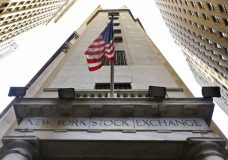 FILE - In this Friday, Nov. 13, 2015, file photo, the American flag flies above the Wall Street entrance to the New York Stock Exchange. Global stocks mostly rose Wednesday, Nov. 22, 2017, after Wall Street hit new highs and Hong Kong's Hang Seng index closed above the 30,000 level for the first time in over 10 years. Trading was slowing, however, ahead of the two-day U.S. break for the Thanksgiving holiday. (AP Photo/Richard Drew, File)