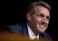 FILE - In this Oct. 31, 2017, file photo, Sen. Jeff Flake, R-Ariz., asks questions during a Senate Committee on Capitol Hill in Washington. Flake said President Donald Trump is certain to face an independent challenge in the next presidential election, if not a challenge from within the party. And Flake is not ruling out being that challenger. (AP Photo/Andrew Harnik, File)
