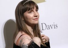 """FILE - In this Feb. 11, 2017 file photo, Lena Dunham attends the Clive Davis and The Recording Academy Pre-Grammy Gala in Beverly Hills, Calif. In a new New York Times report, Dunham claims that she warned Hillary Clinton's communications director about Harvey Weinstein's behavior. She told the Times that when she worked with the Clinton presidential campaign last year, she tried to warn that Weinstein was """"a rapist, and this is going to come out at some point."""" (Photo by Rich Fury/Invision/AP, File)"""
