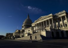 People walk outside the Capitol as Senate Republicans work to pass their sweeping tax bill this week, in Washington, Thursday, Nov. 30, 2017. ( AP Photo/Jose Luis Magana)