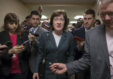 With reporters looking for updates, Sen. Susan Collins, R-Maine, and other senators rush to the chamber to vote on amendments as the Republican leadership works to craft their sweeping tax bill, on Capitol Hill in Washington, Thursday, Nov. 30, 2017. It would mark the first time in 31 years that Congress has overhauled the tax code, making it the biggest legislative achievement of President Donald Trump's first year in office. (AP Photo/J. Scott Applewhite)