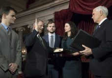 Vice President Mike Pence, right, administers the Senate oath of office during a mock swearing in ceremony in the Old Senate Chamber to Sen. Doug Jones, D-Ala., second from left, with his wife Louise Jones, second from right, Wednesday, Jan. 3, 2018 on Capitol Hill in Washington. They are joined at far left by their son Christopher Jones, and son Carson Jones, center. Jones defeated Republican Roy Moore in a special election to take the seat once held by Attorney General Jeff Sessions. (AP Photo/J. Scott Applewhite)