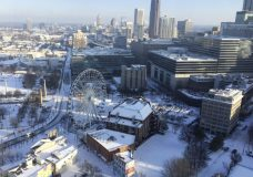 A snow covered downtown is seen, Wednesday, Jan. 17, 2018, in Atlanta. The South awoke on Wednesday to a two-part Arctic mess. First came a thin blanket of snow and ice, and then came the below-zero wind chills and record-breaking low temperatures in New Orleans and other cities. (AP Photo/Janelle Cogan)
