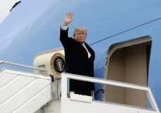 President Donald Trump waves as he boards Air Force One at the Zurich International Airport to fly to Washington, Friday, Jan. 26, 2018 in Zurich, Switzerland after attending the Davos World Economic Forum. (AP Photo/Evan Vucci)