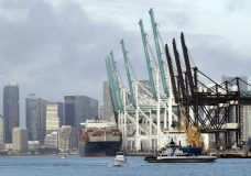 A container ship is docked at the Port of Miami, Monday, Feb. 5, 2018, in Miami Beach, Fla. The Commerce Department reports on the U.S. trade gap for December, on Tuesday, Feb. 6. (AP Photo/Lynne Sladky)