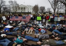 "WEST PALM BEACH, Fla. (AP) — The Latest on President Donald Trump (all times local):  12:40 p.m.  Dozens of teenage students spread their bodies on the pavement in front of the White House to demand presidential action on gun control and symbolize the 17 killed in a school shooting in Florida.  The teenagers were also joined by parents and educators. The protesters held their arms crossed at their chests. Two activists were covered by an American flag. One held a sign asking, ""Am I Next?""  Ella Fesler is a 16-year-old high school student in Alexandria, Virginia. She says, ""It's really important to express our anger and the importance of finally trying to make a change and having gun control in America.""  Fesler adds, ""Every day when I say 'bye' to my parents, I do acknowledge the fact that I could never see my parents again."" President Donald Trump is at his Florida golf club, some 40 miles from the site of the school shooting.   ___  12:20 p.m.  A man hired to drive a press van in President Donald Trump's Florida motorcade has been briefly detained by the Secret Service for bringing a firearm to the job.  The weapon was discovered Monday during a security screening outside Mar-a-Lago as agents checked bags belonging to press and staff. The outside contractor hired to drive a van of journalists in the White House press pool was then pulled aside. He and the other drivers were not allowed to drive the vans on to the club grounds.  The Secret Service said in a statement Monday that the man lawfully possessed a gun that was prohibited in its jurisdiction. It said the incident was investigated with the Palm Beach County Sheriff's Office and no one under Secret Service protection was in danger.  ___  9:55 a.m.  President Donald Trump is spending President's Day at his private golf club in West Palm Beach.  Trump has been in Florida for the weekend. He spent his time largely at his Mar-a-Lago estate as White House aides advised him against golfing too soon after a deadly school shooting in a nearby community.  The White House did not immediately answer questions about whether the president was playing golf Monday. The president also visited the golf club Sunday evening.  An avid golfer, Trump heads to one of his courses almost every weekend.  President Barack Obama took heavy criticism in 2014 when he went golfing during a vacation just minutes after denouncing the militants who had beheaded an American journalist. He later said he ""should've anticipated the optics"" of immediately going to play golf.  ___  9:40 a.m.  The White House says President Donald Trump supports efforts to improve the federal gun background check system after a school shooting in Florida that left 17 dead.  Press Secretary Sarah Huckabee Sanders said Monday that the president had spoken to Sen. John Cornyn, a Texas Republican, about a bipartisan bill designed to strengthen the FBI database of prohibited gun buyers.  Sanders said, ""While discussions are ongoing and revisions are being considered, the President is supportive of efforts to improve the Federal background check system.""  The bill would penalize federal agencies that fail to provide the necessary records and reward states that comply with federal grant preferences and other incentives.  Trump has been a strong supporter of gun rights and the National Rifle Association."