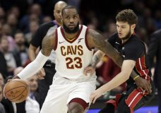 FILE - In this Wednesday, Jan. 31, 2018 file photo, Cleveland Cavaliers' LeBron James, left, drives past Miami Heat's Tyler Johnson in the second half of an NBA basketball game in Cleveland. LeBron James says he will not stick to sports. The Cleveland Cavaliers superstar reiterated his determination to speak out on social issues and the nation's political climate Saturday, Feb. 17, 2018 during his media availability for the NBA All-Star Game. (AP Photo/Tony Dejak, File)
