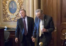 "Sen. Dick Durbin, D-Ill., left, and Senate Minority Leader Chuck Schumer, D-N.Y., walk together outside the chamber during debate in the Senate on immigration, at the Capitol in Washington, Wednesday, Feb. 14, 2018. Schumer said on the Senate floor that ""the one person who seems most intent on not getting a deal is President Trump."" (AP Photo/J. Scott Applewhite)"
