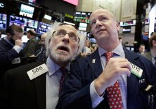 Traders Peter Tuchman, left, and Patrick Casey work on the floor of the New York Stock Exchange, Thursday, Feb. 8, 2018. U.S. stocks are lower Thursday morning as losses from the previous day continue. (AP Photo/Richard Drew)