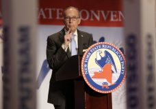 """FILE- In this May 14, 2014, file photo, Larry Kudlow speaks at the New York State Republican Convention in Rye Brook, N.Y. For a decade and a half, Kudlow has been a fixture on CNBC. On Tuesday, March 13, 2018, President Donald Trump said he was looking """"very strongly"""" at naming Kudlow, who has spent decades writing and speaking about economic policy, to be director of the National Economic Council. (AP Photo/Seth Wenig, File)"""