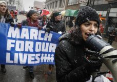 "Organizer Rasleen Krupp, 17, Wyoming High School, leads a ""March for Our Lives"" protest for gun legislation and school safety, Saturday, March 24, 2018, in Cincinnati. Students and activists across the country planned events Saturday in conjunction with a Washington march spearheaded by teens from Marjory Stoneman Douglas High School in Parkland, Fla., where over a dozen people were killed in February. (AP Photo/John Minchillo)"