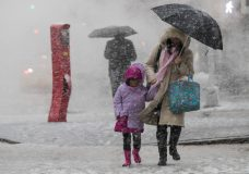 Pedestrians walk along Delancey St. during a snowstorm, Wednesday, March 7, 2018, in New York. The New York metro area was hit with another winter storm Wednesday just days after another nor'easter hammered the region with high winds. (AP Photo/Mary Altaffer)