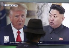 """FILE - In this Aug. 10, 2017, file photo, a man watches a television screen showing U.S. President Donald Trump and North Korean leader Kim Jong Un during a news program at the Seoul Train Station in Seoul, South Korea. South Korea's national security director says President Donald Trump has decided he will meet with North Korea's Kim Jong Un """"by May."""" Chung Eui-yong spoke outside the White House, Thursday, March 8, 2018, after a day of briefings with senior U.S. officials, including Trump, on the recent inter-Korea talks. Chung says Trump said """"he would meet Kim Jong Un by May to achieve permanent denuclearization"""" of the Korean peninsula. (AP Photo/Ahn Young-joon, File)"""
