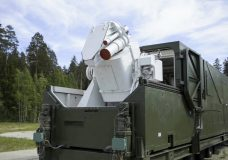 In this video grab provided by RU-RTR Russian television via AP television on Thursday, March 1, 2018, a Russian military truck with a laser weapon mounted on it is shown at an undisclosed location in Russia. President Vladimir Putin declared Thursday that Russia has developed a range of new nuclear weapons, claiming they can't be intercepted by enemy. (RU-RTR Russian Television via AP)