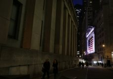 FILE- In this Feb. 17, 2017, file photo an American flag hangs on the front of the New York Stock Exchange in New York. The U.S. stock market opens at 9:30 a.m. EDT on Friday, April 27, 2018. (AP Photo/Peter Morgan, File)