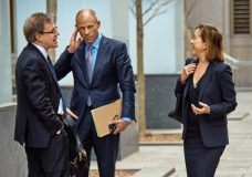 Attorney Joanna Hendon, representing President Donald Trump, second right, talks to Michael Avenatti, attorney and spokesperson for adult film actress Stormy Daniels, second left, at Federal court, Friday, April 13, 2018, in New York. A hearing has been scheduled before U.S. District Judge Kimba Wood to address President Trump's personal attorney, Michael Cohen's request for a temporary restraining order related to the judicial warrant that authorized a search of his Manhattan office, apartment and hotel room this week. (AP Photo/Andres Kudacki)