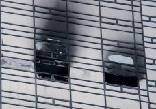 A firefighter looks out from the window of a fire damaged apartment in Trump Tower in New York on Saturday, April 7, 2018. The Fire Department says the blaze broke out on the 50th floor shortly before 6 p.m. Saturday. (AP Photo/Craig Ruttle)