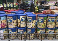 Imported nuts from the United States are displayed for sale at a supermarket in Beijing, Monday, April 2, 2018. China raised import duties on U.S. pork, fruit and other products Monday in an escalating tariff dispute with President Donald Trump that companies worry might depress global commerce. (AP Photo/Andy Wong)