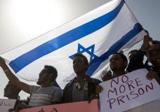 """FILE - In this Feb. 22, 2018 file photo, asylum seekers march during a protest outside Israeli Prison Saharonim, in the Negev desert, southern Israel. Prime Minister Benjamin Netanyahu's office said Monday, April 2, 2018, that it has reached an agreement with the United Nations refugee agency to scrap plans to deport African asylum seekers and will resettle many in Western countries instead. Israel said it reached an """"unprecedented understandings"""" with the U.N. in which Israel will send more than 16,000 migrants to various Western countries willing to absorb them. (AP Photo/Tsafrir Abayov, File)"""