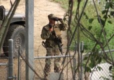FILE - In this April 10, 2018, file frame from video, a National Guard troop watches over Rio Grande River on the border in Roma, Texas. The deployment of National Guard members to the U.S.-Mexico border at President Donald Trump's request was underway with a gradual ramp-up of troops under orders to help curb illegal immigration. (AP Photo/John Mone, File)