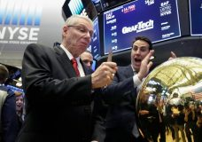 New York Stock Exchange Global Head of Listings John Tuttle, right, watches as GrafTech International Ltd. CEO Dave Rintoul, left, breaks the gavel as Rintoul rings a ceremonial bell to mark his company's IPO, Thursday, April 19, 2018. (AP Photo/Richard Drew)