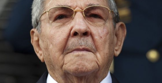 """FILE - In this March 17, 2015 file photo, Cuba's President Raul Castro listens to the playing of national anthems during his welcome ceremony at the Miraflores presidential palace in Caracas, Venezuela. On April 19, 2018 Raul Castro will step down as president after a decade in office. The world should expect no immediate radical change from a single-party system dedicated to stability above all else. Raul Castro will remain first secretary of the Communist Party, described by the Cuban constitution as the country's """"highest guiding force."""" (AP Photo/Ariana Cubillos, File)"""